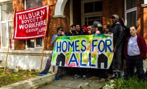 Kilburn Unemployed Workers Group attempt to resist the eviction of a private tenant. Photo by Louppy Hart