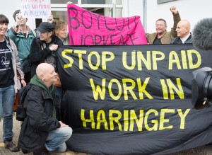 crowd with boycott workfare banner